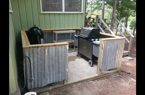 BBQ Patio with propane and charcoal grills and a smoker