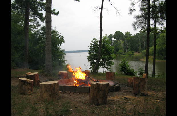 The fire pit with re-purposed pine logs for seats